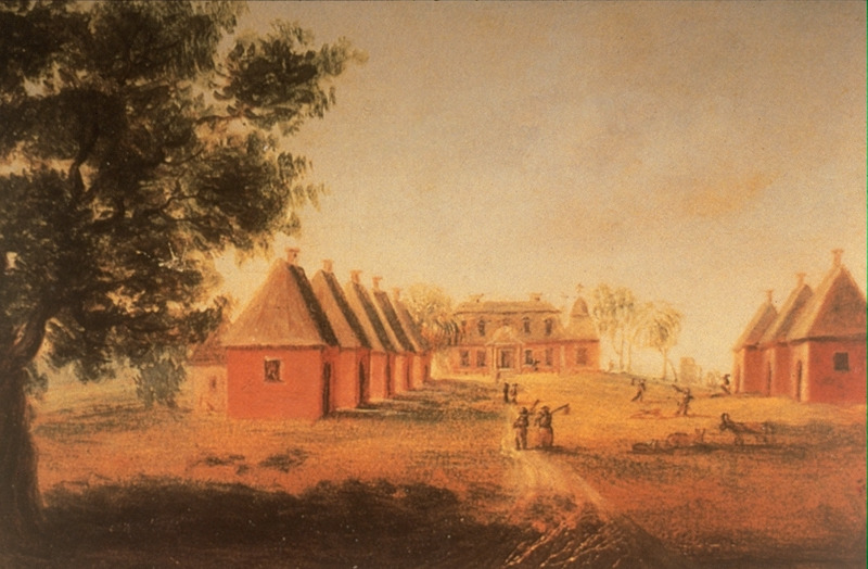 Painting shows the manor/plantation/main house (center). Shown are the one-room slave houses and people carrying long-handled hoes over their shoulders.