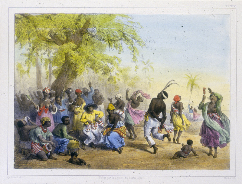 """""""The Dou, or Great Festival of the Slaves"""" (caption translation). This engraving shows a large crowd of people celebrating and playing drums under a big tree in the jungle. On the left, a person holds a rattle, or the maccari, a small instrument which makes the same noise as a vessel filled with stones. The women hold it in their right hand and pound the beat with the left hand. Benoit wrote that """"enslaved people and creole blacks place great emphasis on dancing in general and particularly on gatherings which they call Dou. The Dou is ordinarily danced by the negros and by the slaves, above all on New Year's day. It is in these kinds of get togethers that they forget the shovel/fork and the whip, and they appear in all kinds of fancy clothing which is very different from the clothing they wore the day before or will wear the following day when going out to work"""" (p. 23). Pierre Jacques Benoit (1782-1854) was a Belgian artist, who visited the Dutch colony of Suriname on his own initiative for several months in 1831. He stayed in Paramaribo, but visited plantations, maroon communities and indigenous villages inland."""