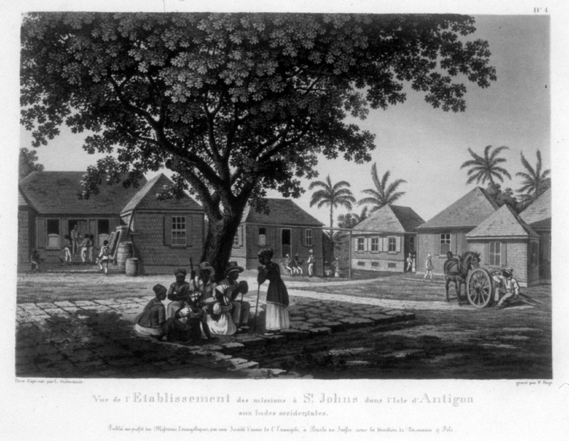"""""""View of the establishment of missions in St. John in the island of Antigua in the West Indies"""" (caption translation). This image shows a Moravian mission station with buildings in the background and people in the foreground. One of a set of four separately published engravings, which were likely compiled by John Henry Lewis Stobwasser, probably the son of Johann Heinrich Stobwasser (1740-1829), who was a Moravian missionary in Antigua from 1812 until 1822."""
