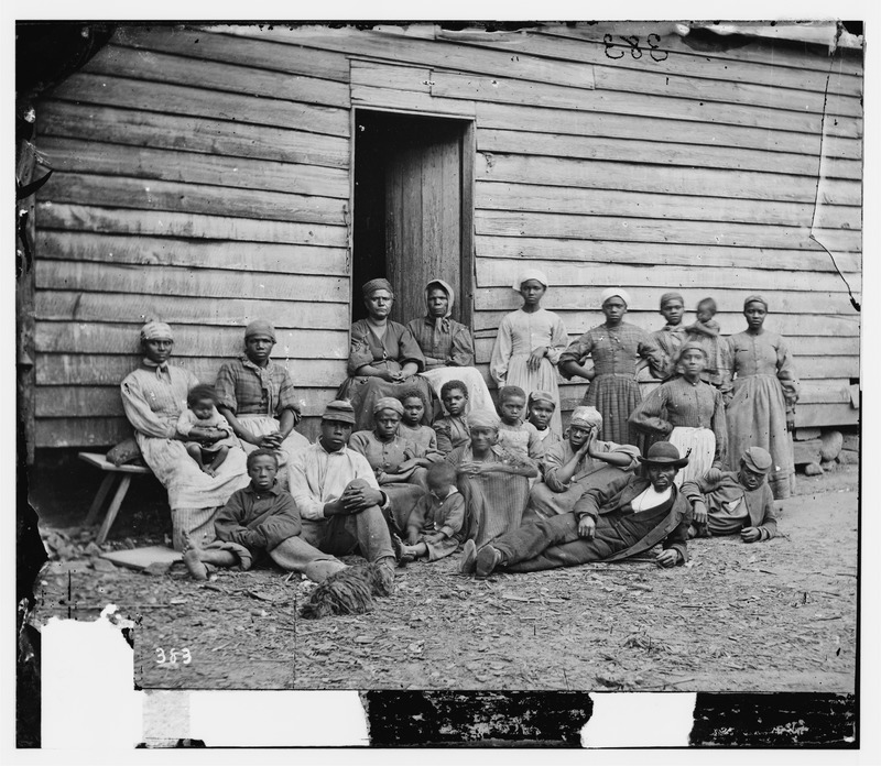 Fugitive slaves from the South who escaped to Union lines were called contraband, that is, confiscated enemy property. They were held in camps while the military authorities decided how to maintain and employ them. The people in this photograph, taken at Foller's house in Cumberland Landing (Central Virginia), would have posed a particular dilemma for the authorities because they were largely women and children and could not be used, as were able-bodied males, for hard military labor or soldiering. By 1862, when this photograph was taken, women and children would be moved to contraband camps, meaning confiscated southern plantations, which were used to grow food for the Union army. (Thanks to William Freehling for his assistance in interpreting this photograph.)