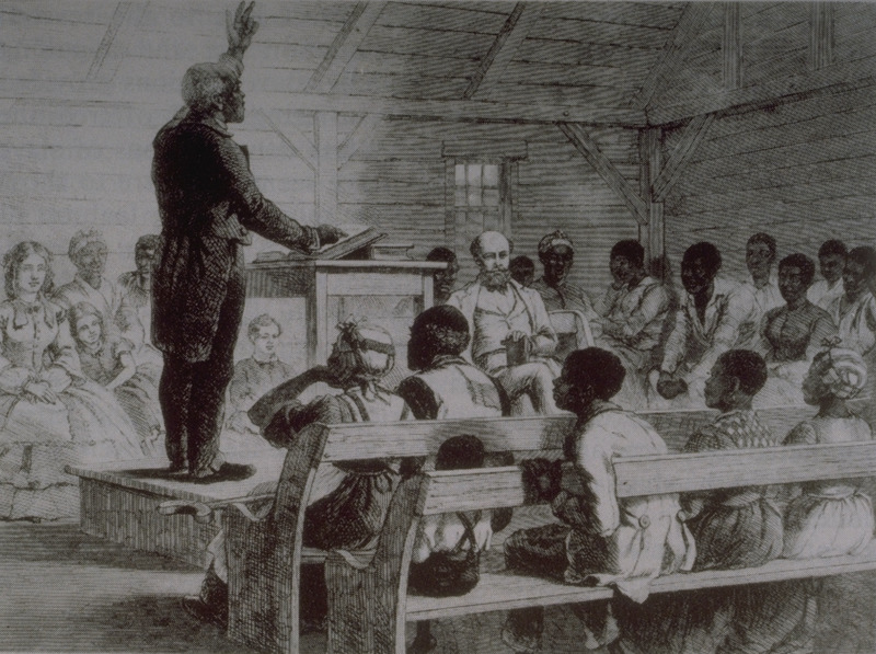 A slave preaching to a congregation of slaves and the plantation owner and his family. The preacher was a house slave who could read but not write. This illustration is from a sketch made in a rude chapel erected for the slaves on this cotton plantation, near Port Royal, South Carolina. The Methodist persuasion is the one which finds most favour among the slaves in the Southern as well as among the free Negroes in the Northern States ( p. 574).
