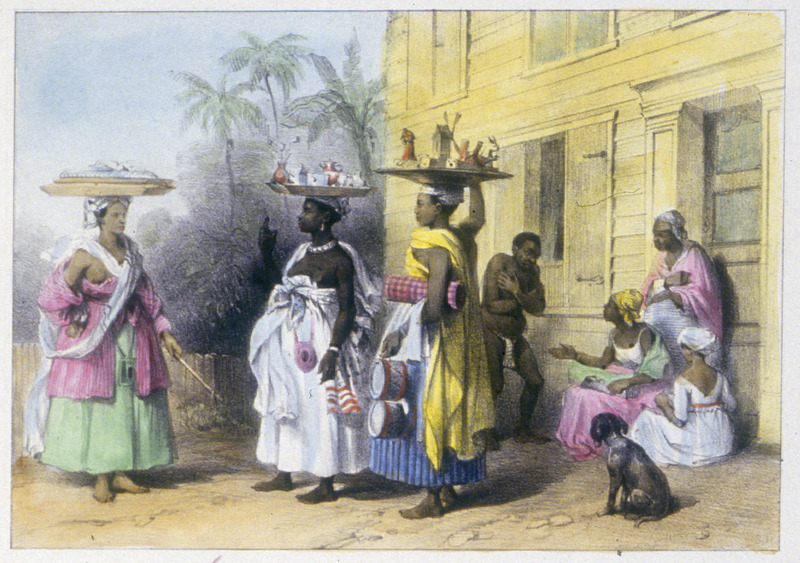 """""""Three Merchants by the Toilets or Traders, Creole, Negro-Creole and Cabougle or African"""" (caption translation). This engraving shows three market women or retailers of various dry goods with wood trays on their heads. The man clad in a loincloth appears to be enslaved, but it is unclear what he is doing exactly, although it could relate to using the toilet. Pierre Jacques Benoit (1782-1854) was a Belgian artist, who visited the Dutch colony of Suriname on his own initiative for several months in 1831. He stayed in Paramaribo, but visited plantations, maroon communities and indigenous villages inland."""