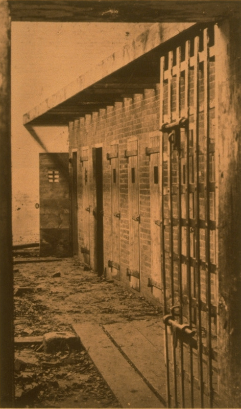 Photo of cells/pens where slaves were held prior to being sent to markets in the Lower South. Campbell and Rice write that slave traders in such upper south cities as Alexandria, Richmond, and Norfolk were the main suppliers of slaves for New Orleans, the largest slave market. In Alexandria, the widely known firm of Price, Birch & Company collected slaves in crowded pens before they were 'sold south'  (p. 138). For a companion photo, see image Dugan-2 on this website