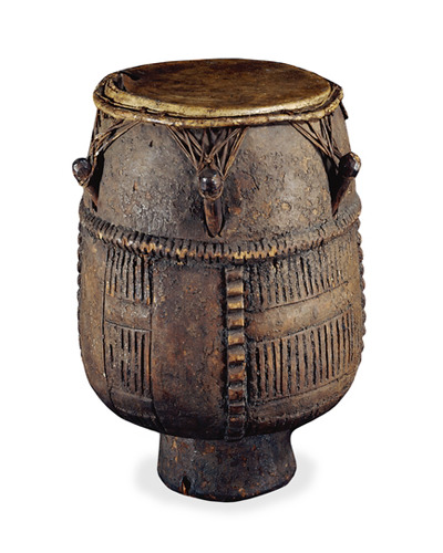 An Akan-style wooden drum (approximately sixteen inches high), originally from the southern Gold Coast, West Africa. It was transported across the Atlantic, probably on a slave ship, and collected by a Reverend Clerk in Virginia. Evidently, the drumhead was reskinned (likely with the American white-tailed deer) in America before Clerk sent the drum in the 1720s or 1730s to Sir Hans Sloane, a prominent English physician and naturalist. Upon Sloane's death, the drum became part of the founding collection of the British Museum in London (where it is still housed). Initially misidentified in the museum's collections as an Indian drum (suggesting that it may have been collected from a Native American group), the object was correctly identified as African in 1906. Drums were the most common musical instruments used on eighteenth-century British slave ships when captive Africans were forced to dance for exercise, and this drum may have served that purpose. Aside from archaeological specimens of African origin (e.g., Newton Plantation Cemetery images on this website) this is one of the oldest known ethnographic objects of African origin that migrated to North America via the transatlantic slave trade. For details, see the British Museum website (www.britishmuseum.org) and Devorah Romanek, To the Beat of the Drum, British Museum Magazine (Autumn 2010), pp. 28-29. Thanks to John Davy of the British Museum for his help in interpreting this object. For drums on slave ships, see Handler, The Middle Passage and the Material Culture of Captive Africans, Slavery and Abolition (Vol. 30, March 2009), pp. 1-26.