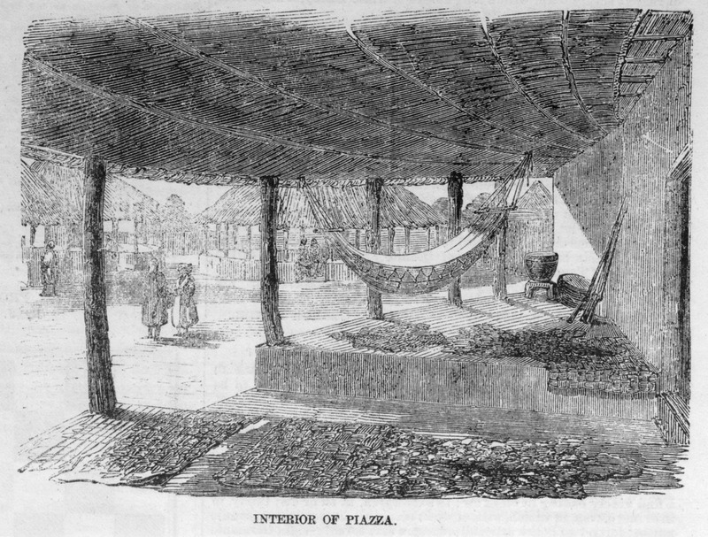 Caption, interior of piazza, shows houses, hammock, and various items in village near Freetown; described in article (p. 436).
