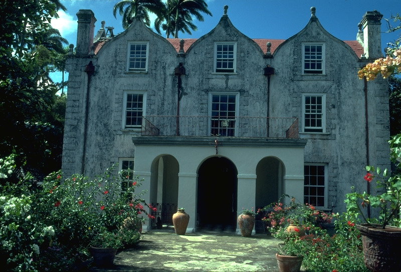 Nicholas Abbey was built of locally obtained coral blocks in the 1650s and is one of the oldest standing plantation houses in Barbados. It is one of three Jacobean-style English manor houses in what was once British America (the others are Drax Hall in Barbados and Bacon's Castle, Williamsburg, Virginia). This photo shows the front entrance of the plantation house (the entrance portico was added long after initial construction); note the chimneys to the fireplaces. The site of the former slave village is very close to the house. The plantation itself, during the period of slavery, was large in terms of acreage and enslaved population by standards of the island. (For a history of the plantation, its main house, and its enslaved population, see Jerome Handler et al., Searching for a slave cemetery in Barbados [Southern Illinois University at Carbondale, Center for Archaeological Investigations, Research Paper No. 59, June 1989], passim.)