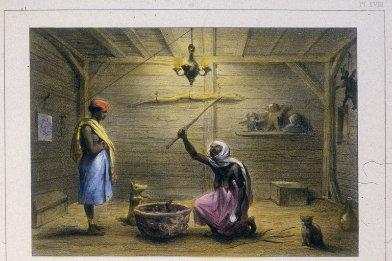 """The Mama-Snekie, or Water-Mama, Doing His Conjurations"" (caption translation). This lithograph shows a female diviner kneeling before a bowl holding a stick in the air, while a man stands and watches the ceremony. According to Benoit, ""using her spiritual powers, a healer is helping to cure a child who is not present. After engaging in certain ritualistic behaviors, she gives the mother, who stands before her, a herbal decoction, made in the pot in front of her; the mother is told to drink the decoction several times and then is given some herbs which she is to give her child. These healers, who are regarded as oracles by the Negroes, are usually older black women who are called Mama Snekie, Mother of Serpents, or Water Mama."" Benoit observed one of these women at work, and describes the scene he witnessed, including the furnishings of her house. Although his description is relatively brief and sparse in ethnographic detail, it nonetheless represents a rather unique first-hand account of an African-type spiritual practitioner. Pierre Jacques Benoit (1782-1854) was a Belgian artist, who visited the Dutch colony of Suriname on his own initiative for several months in 1831. He stayed in Paramaribo, but visited plantations, maroon communities and indigenous villages inland."