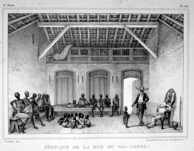 """Boutique on Val-Longo Road"" (caption translation). This engraving shows slaves in a building on the street of the slave market in Rio de Janeiro. Adults ranged along benches, children were playing on the floor; two Europeans present. Jean-Baptiste Debret (1768–1848) was a French painter, who produced lithographs depicting people during his residence in Brazil from 1816 to 1831. The Portuguese court commissioned Debret to paint their portraits, but he took a particular interest painting enslaved Africans and indigenous peoples. See also Jean Baptiste Debret, Viagem Pitoresca e Historica ao Brasil ([Paris, 1854]; Editora da Universidade de Sao Paulo, 1989)."