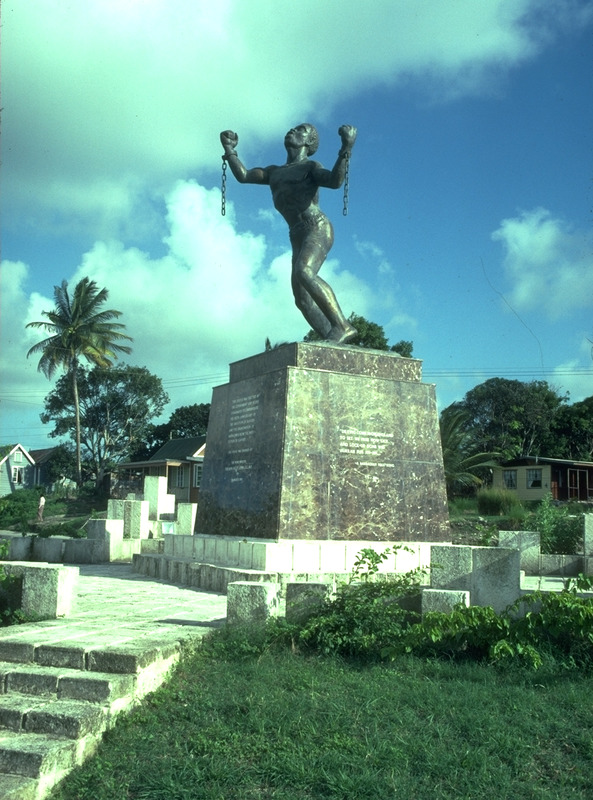 Larger than life-sized statue of unknown slave, with broken shackles. Named Slave in Revolt by its creator, the Barbadian sculptor Karl Broodhagen, this statue was commissioned by the government of Barbados to commemorate the 150th anniversary of slave emancipation in the British colonies; it was unveiled in March 1985.
