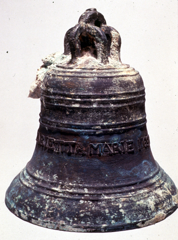 Photo of archaeologically-recovered ship's bell, which is partially encrusted, but the name of the ship is still visible. The Henrietta Marie transported about 200 slaves from the Bight of Biafra to Jamaica in 1699-1700.