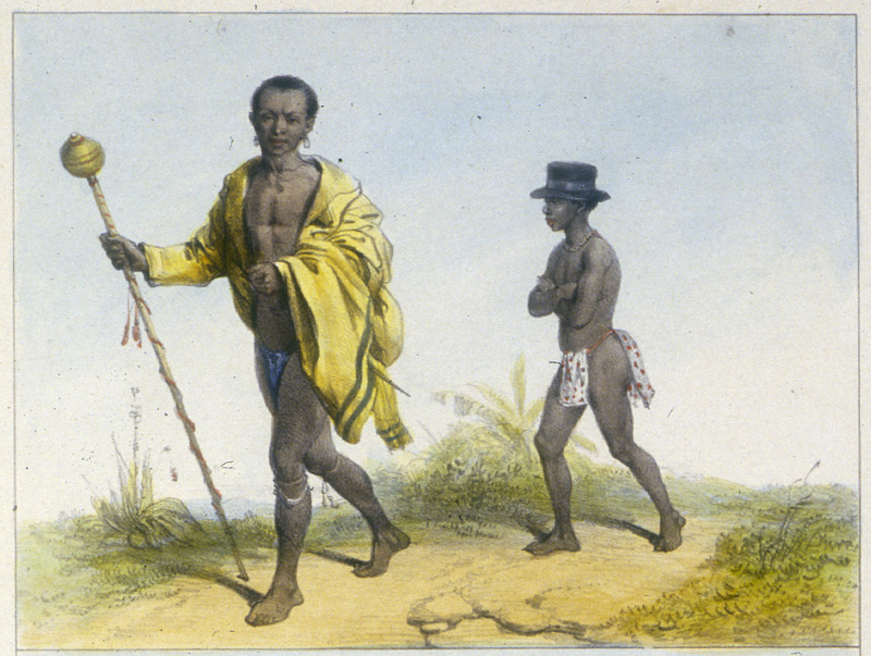 """""""An Elder and his Slave"""" (caption translation). This engraving shows two men walking along a path. After remarking on a foreigner's difficulty in ascertaining status and rank differences among the Bush Negroes (since they are not differentiated by their clothing), Benoit described a scene in which one of these people arrived at Paramaribo by canoe with two other villagers. He wrote that they """"all wore only loincloths, and none was distinguished from the other by clothing, except the eldest wore iron and coral arm and leg ornaments and an unsheathed cutlass around his waist. After disembarking, however, the elder proceeded to don a robe and carry an elaborate staff; his own slave put on a top hat and followed the elder into town."""" Pierre Jacques Benoit (1782-1854) was a Belgian artist, who visited the Dutch colony of Suriname on his own initiative for several months in 1831. He stayed in Paramaribo, but visited plantations, maroon communities and indigenous villages inland."""