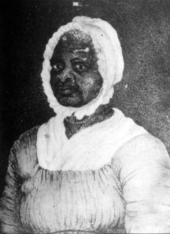 This miniature watercolor (3.5 cm x 5.5 cm) shows the face and upper torso of Elizabeth Freeman (c.1744-1829), also known as Bet or Mama Bet. It remains unclear if Freemen was African, or born in New York state of African parents. She was purchased when young and became a servant in a Massachusetts household. After an incident of maltreatment, she left her owner and enlisted the aid of a Massachusetts antislavery lawyer, Thomas Sedgwick. She was the first enslaved African American to file and win a freedom suit in Massachusetts in 1781. The Massachusetts Supreme Court ruling, in Freeman's favor, found slavery to be inconsistent with the 1780 Massachusetts State Constitution. She died in 1829 and was buried in a segregated section of the Stockbridge, Massachusetts graveyard. Her portrait was painted by Susan Sedgwick, Thomas's daughter. For biographical details on Freeman's life, see Harriet Martineau, Retrospect of Western Travel (New York, 1838), vol. 2, pp. 104-10.