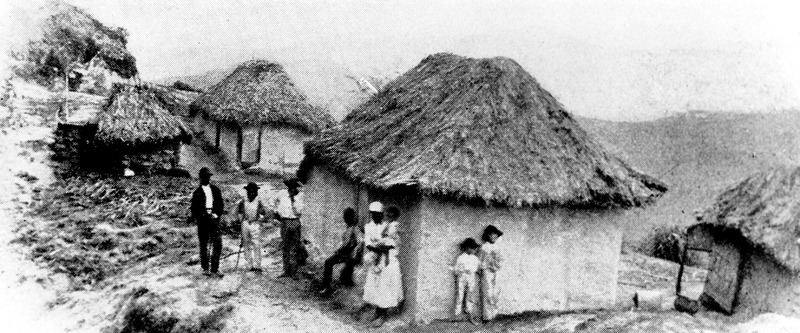 Thatched houses in a Scotland District village. Two working-class white children are shown leaning against the house on the right. Although many years after slave emancipation in 1834-38, these houses probably closely resemble those inhabited by slaves in earlier periods. Barbados had a relatively large poor white population, many of whom lived in villages on the eastern (Atlantic) side of the island. See J. S. Handler and S. Bergman, Vernacular Houses and Domestic Material Culture on Barbados Sugar Plantations, 1650-1838. Jl of Caribbean History 43 (2009) : 1-36.